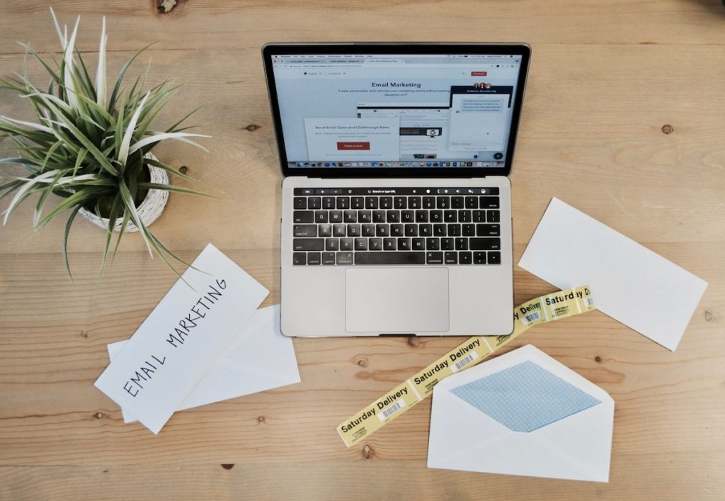 Image of desk clutter with an email marketing theme.