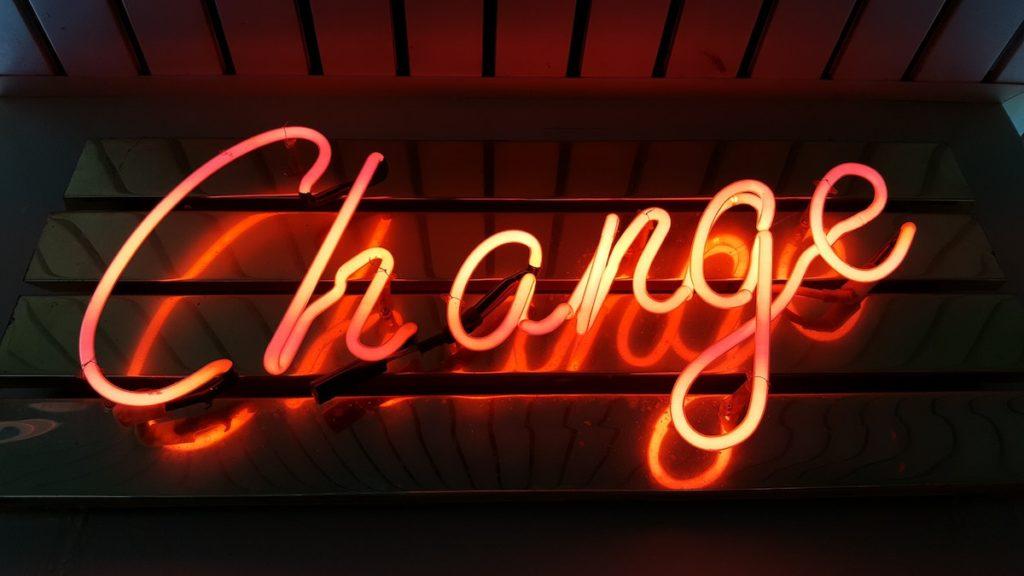 "Neon sign, says ""change."""