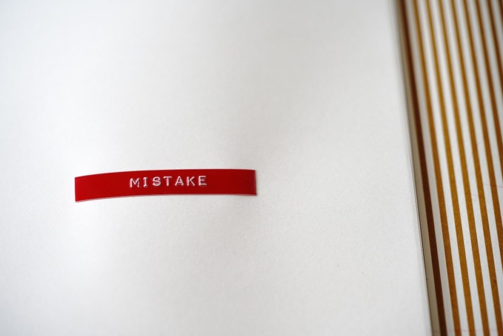 A red label that says 'mistake.'